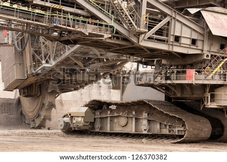 HAMBACH, GERMANY - SEPTEMBER 1: A close-up of one of the world's largest bucket-wheel excavators digging lignite (brown-coal) in of the world's deepest open-pit mines in Hambach on September 1, 2010 - stock photo