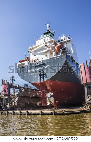 HAMBURG, GERMANY - APRIL 19, 2015: A large yacht is lying in the drydock, in the harbor of Hamburg, Germany. - stock photo