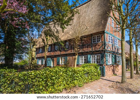 HAMBURG, GERMANY - APRIL 19. Old half-timbered house as a restaurant in Hamburg district Altona on April 19, 2015. It is a local landmark for the district Hamburg Altona built in 1759 - stock photo