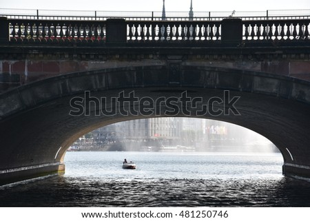 HAMBURG, GERMANY - AUG 26: Bridge over Lake Alster in Hamburg, Germany, as seen on Aug 26, 2016. Hamburg was founded at the mouth of Alster river in the 9th century and has been used as a port since.