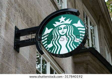 HAMBURG, GERMANY - AUGUST 14, 2015: Starbucks Coffee logo light box, this company is the largest coffeehouse company in the world - stock photo