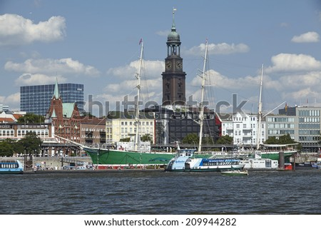 HAMBURG, GERMANY - AUGUST, 8. The St. Michaelis Church at the Harbor of Hamburg taken at bright sunlight with blue sky and white clouds on August 8, 2014.