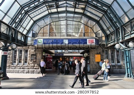 HAMBURG, GERMANY - AUGUST 28, 2014: Travelers visit the Central Railway Station (Hauptbahnhof) in Hamburg. With 450,000 daily passengers it is the 2nd busies station in Europe.