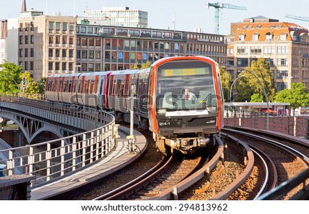 HAMBURG, GERMANY - JULY 25, 2014: Train arrives at Baumwall U-Bahn Station in Hamburg. Hamburg U-Bahn (Metro Rapid Transit System) was opened in 1912 and comprises four lines serving 91 stations - stock photo