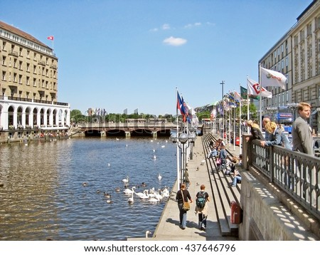 Hamburg, Germany - May 22, 2008: At the channel Kleine Alster / Jungfernstieg. People resting on stairs.