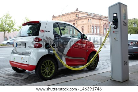 HAMBURG, GERMANY - MAY 30: Electric car at a charging station on the Glockengieserwall street near the Hamburg Kunsthalle on May 30, 2012 in Hamburg, Germany. - stock photo