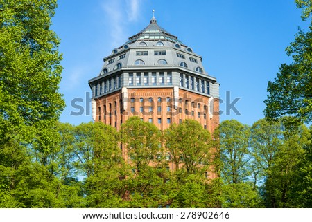 HAMBURG, GERMANY - MAY 10. Europe's largest former Water Tower Schanzenturm in the Hamburg district Sternschanze on May 10, 2015. The tower has been converted into a hotel. A landmark in Hamburg - stock photo