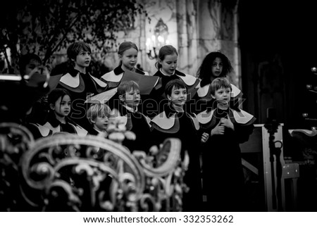 HAMBURG, GERMANY - MAY 29: Members of child Choir (EST) sing at the St. Michael Church -  - one of the well known landmarks of Hamburg, May 29, 2015 in Hamburg, Germany - stock photo