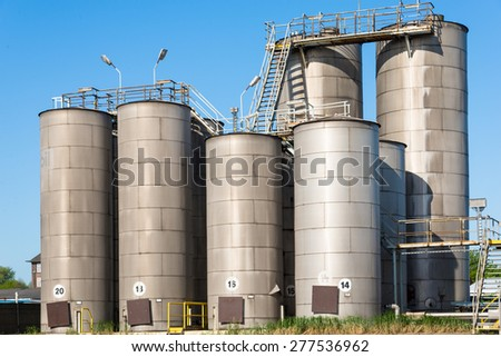HAMBURG, GERMANY - MAY 06. Storage tanks with marine diesel oil in the harbor of Hamburg on May 06, 2015. Plenty of cargo ships needs oil and equipment for the long journey by sea. - stock photo