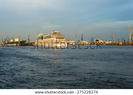 HAMBURG, GERMANY - MAY 04. The AIDA Cruise ship in the harbor of Hamburg on May 04, 2015. The cruise ship leaves the harbor and goes on deep sea. Hamburg has two big cruise ports for Cruise liner - stock photo