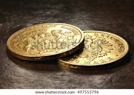 Hamburg gold coins (German Empire Goldmark) on rustic wooden background