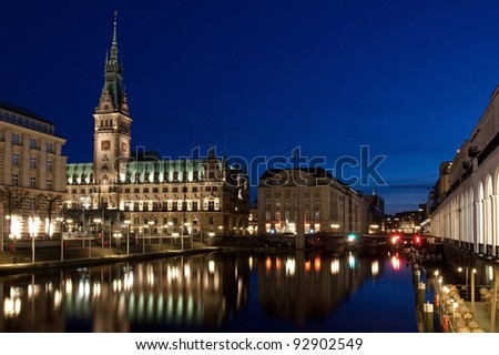 Hamburg Rathaus (city hall) at night with the Small Alster and the Alster arcades. - stock photo