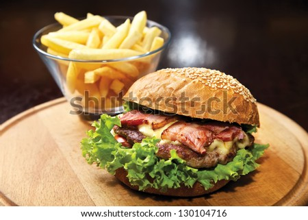 Hamburger. Beef, bacon, cheese, tomatoes, onion, green salad and french fries