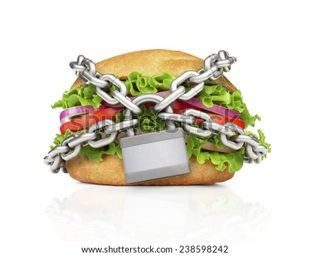 Hamburger constrained with chain. Choose healthy food. - stock photo