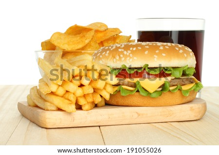 Hamburger, french fries and chips with cola on white background