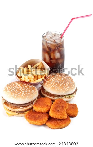 Hamburger, french fries, chicken nuggets and cola on a white background