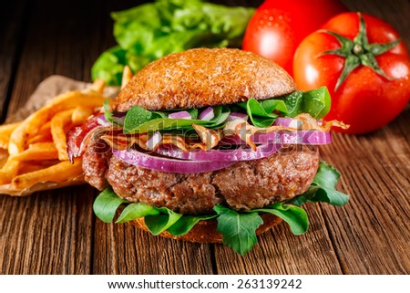 Hamburger. Hamburger on wooden background. Vintage Hamburger. Home made burger. Fastfood meal. Pub burger. Delicious Hamburger. Gourmet hamburger. Hamburger on wooden table. Rustic Hamburger, bun.