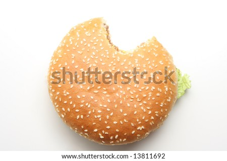 Hamburger isolated on white, one bite taken out of it - stock photo