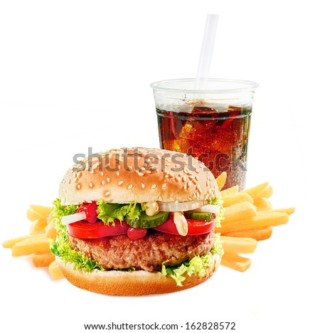 Hamburger on a asesame bun with iced soda drink and crisp golden potato French fries on a white background - stock photo