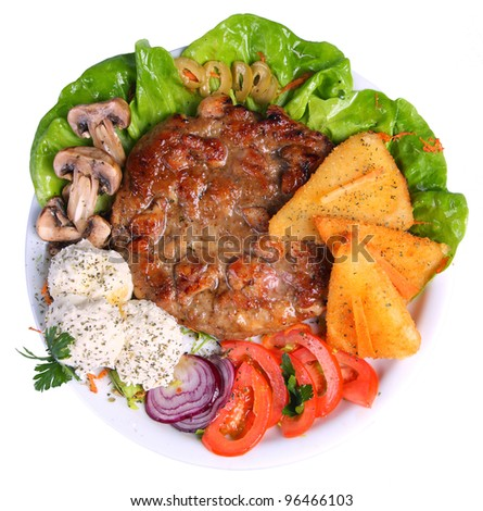 Hamburger on a platter with cheese, tomatoes, mushrooms, onions and lettuce, top angle - stock photo