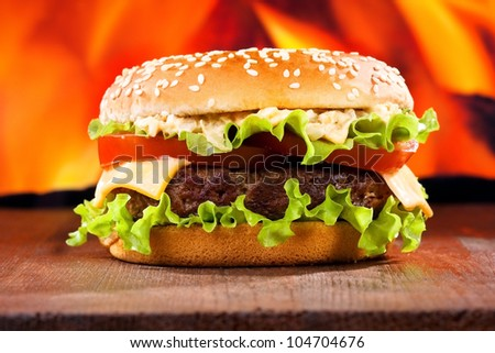 hamburger on fire background