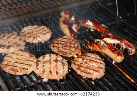Hamburger patties on the grill - stock photo