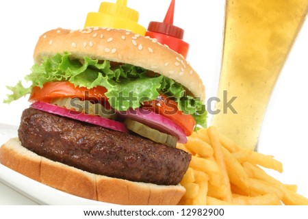 Hamburger served with french fries and cold beer angled. Fast food & barbecue collection. - stock photo