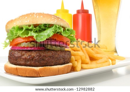 Hamburger served with french fries and cold beer. Fast food & barbecue collection. - stock photo