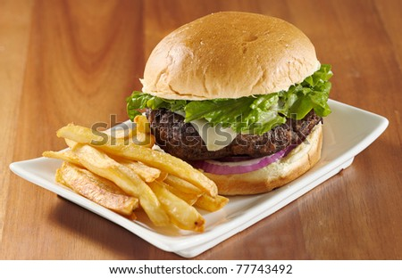 hamburger with french fries on a plate. Selective focus on hamburger. - stock photo