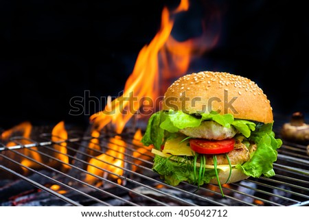 hamburger with grilled meat and cheese on a barbecue - stock photo