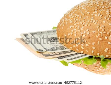 Hamburger with money on the white background. - stock photo