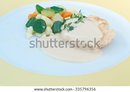 Hamburger with mustard sauce and crispy vegetables