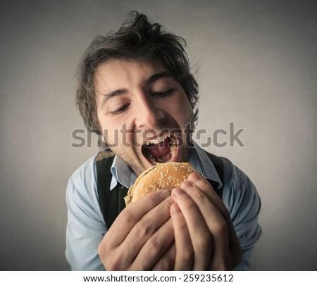 Hamburgers lover  - stock photo