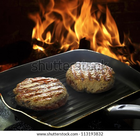 hamburgers on the grill - stock photo
