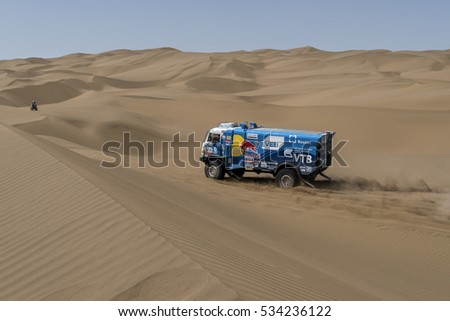 HAMI, CHINA-JULY 18, 2016: Sports truck gets over the difficult part of the route during the Silk Way rally Moscow-Beijing Dakar series in the sand desert