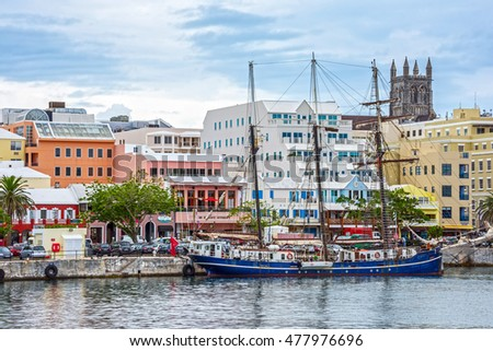 HAMILTON,BERMUDA, MAY 25 - An old tall ship and colorful buildings are typical of the view on May 25 2016 in Hamilton,Bermuda.