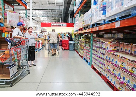 HAMILTON, CANADA - JULY 1, 2016: Costco Wholesale store in Ontario, Canada. The company operates a chain of membership warehouses, carrying merchandise at lower prices.  - stock photo