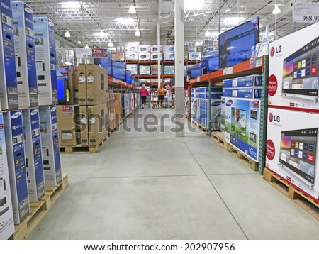 HAMILTON, CANADA - JULY 4, 2014: Television corridor in Costco Wholesale store in Hamilton Ontario, Canada. Costco operates a chain of membership warehouses, carrying merchandise at lower prices.  - stock photo