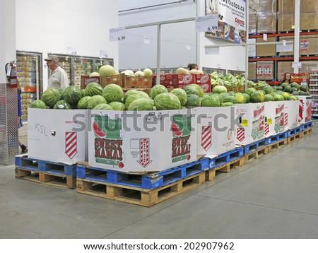 HAMILTON, CANADA - JULY 4, 2014: Watermelon corridor in Costco Wholesale store  Hamilton Ontario, Canada.  Costco operates a chain of membership warehouses, carrying merchandise at lower prices.  - stock photo