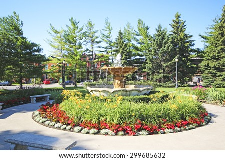 HAMILTON, ONTARIO - JULY 20, 2015: Fountain in garden outside LIUNA station, Hamilton. Hamilton is the centre of a densely populated and industrialized region at the west end of Lake Ontario  - stock photo