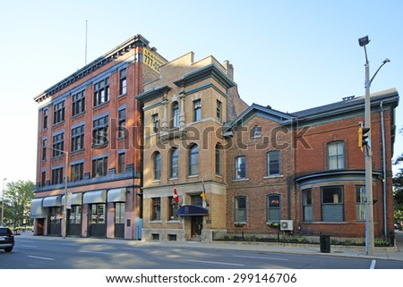 HAMILTON, ONTARIO - JULY 20, 2015: Victorian commercial building of Hamilton. Hamilton is the centre of a densely populated and industrialized region at the west end of Lake Ontario  - stock photo