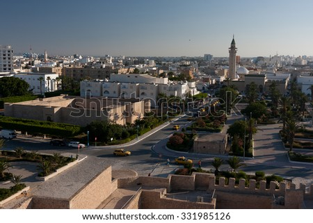 HAMMAMET, TUNISIA - JULY 16, 2012: The modern promenade with the view on high walls of Medina, on July 16 in Hammamet. - stock photo