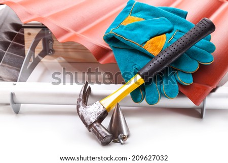 Hammer, a roof made �¢??�¢??of polycarbonate in the form of tiles, gloves, plumb, screw on a white background - stock photo