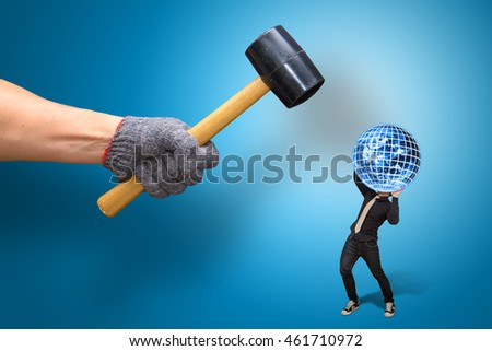 Hammer Against Business Man and earth : Elements of this image furnished by NASA