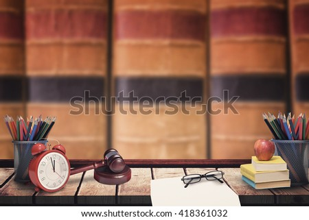 Hammer and gavel against close up of old books - stock photo