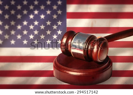 Hammer and gavel against digitally generated american national flag - stock photo