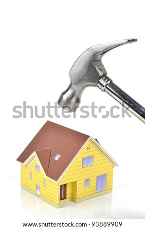 Hammer and model house - stock photo