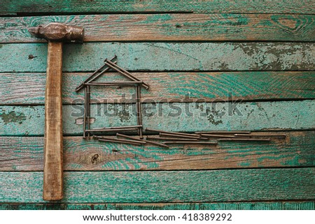 Hammer and nails on a wooden surface. Joinery tradition. Construction concept. - stock photo