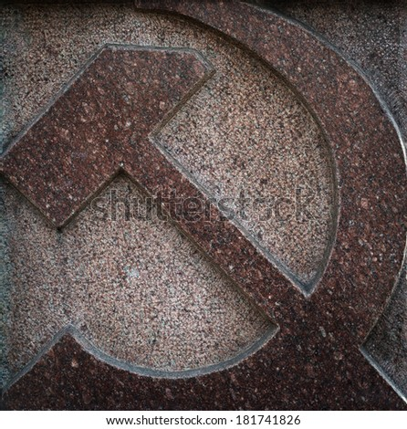 Hammer and sickle made of granite - soviet symbol. - stock photo