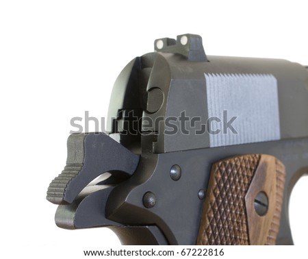 hammer cocked on a semi-automatic handgun ready to go